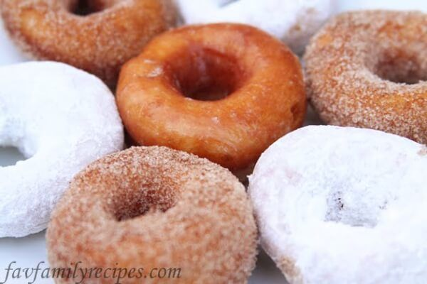 These Homemade Doughnuts are light and delicious! We coated some with cinnamon and sugar, some with powdered sugar, and even glazed a few.