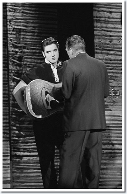 Elvis Presley and Ed Sullivan : Rehearsals : The Ed Sullivan Show : New York, October 26, 1956.    Above, Ed Sullivan standing in front of Elvis, on stage during a break of some sort. Ed was reminding Elvis that this was a family show and he wanted no part of the hip swinging and suggestive movements that had given rise to such negative comments from the first show. You can see in the picture Elvis rolling his eyes up - this really says it all. In Elvis's next appearance, Sullivan simply had…