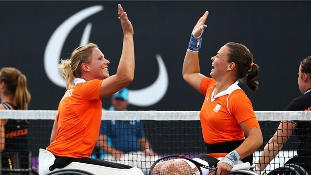 Marjolein Buis (R) and Esther Vergeer (L) of Netherlands celebrate winning the gold medal against Jiske Griffioen and Aniek Van Koot of Netherlands in the women's Tennis Doubles gold medal match on Day 10 of the London 2012 Paralympic Games at Eton Manor.