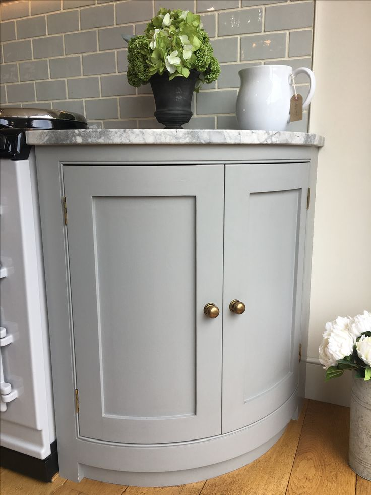 Our curved end cabinet with simple aged brass handles ...