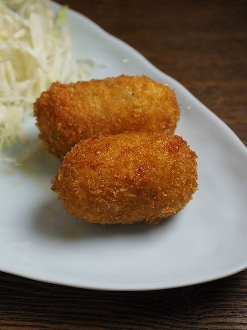 KOROKKE aka JAPANESE-STYLE CROQUETTE ~~~ croquettes are made of are chopped meat, seafood, or vegetables with mashed potato or white sauce that are then rolled in wheat flour, eggs, and breadcrumbs prior to deep-fry. in japan, they are most often eaten with a thick worcestershire-style dipping sauce (tonkatsu sauce) and shredded cabbage. recipe gateway: this post's link + a basic potato-only construct version at http://www.japanesecooking101.com/potato-korokke-recipe/ [Japan] [yamaken]