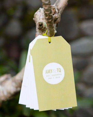 Shape wedding programs like luggage tags to match a destination wedding theme.