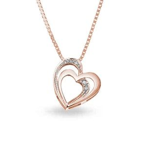 KLENOTA Double heart pendant adorned with diamonds. Crafted in 14kt rose gold.