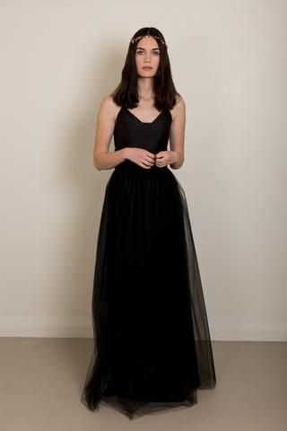 Black tie outfit inspo: Black top and black tulle skirt ensemble with a gold hair garland.