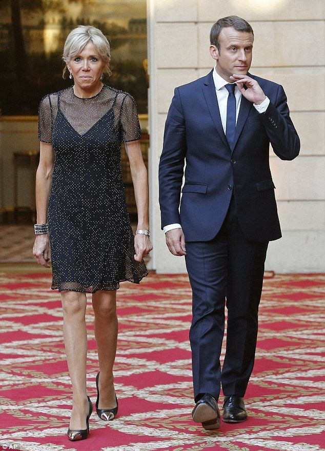 Power couple: France's President Emmanuel Macron, right, and his wife Brigitte Macron - st...
