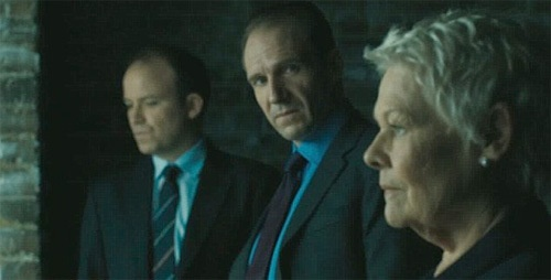 "Rory Kinnear as Tanner, Ralph Fiennes as Mallory, and Judi Dench as M in ""Skyfall"""