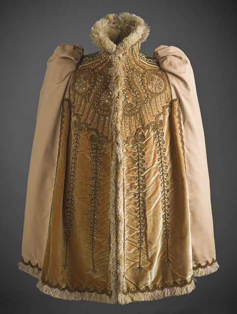 Woman's Mantle, circa 1891 ~ by designer Emile Pingat (contemporary of Charles Worth - equally prominent but focus on outer wear).  Wool weave & silk velvet with silk & metallic-thread embroidery, glass beads, and ostrich-feather trim. (1st of two pins)