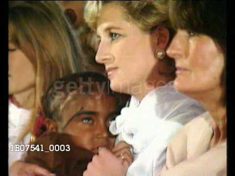 February 22, 1996: Princess Diana sits with Imran and Jemima Khan and their family watching young girls dance and cradling a sick child in her arms on her visit to Lahore, Pakistan. Video.