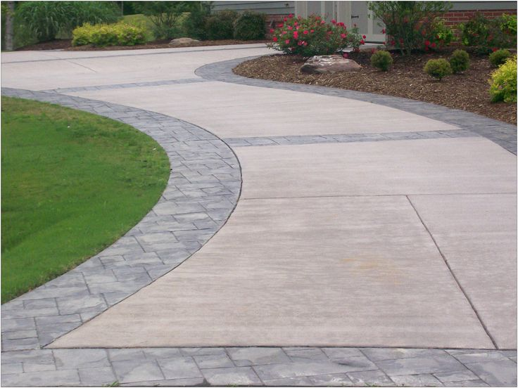 stamped border driveway with broom finish interior slick finish concrete slab with stamped border tear shaped patio with stamped border and broom finish - Concrete Driveway Design Ideas