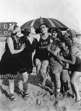 Harold Lloyd with some movie bathing cuties on the beach at just north of the SM Pier during shooting for The Sad Seas Waves 1917