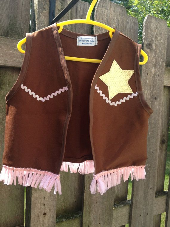 Halloween costume, birthday or anytime. Brown twill fabric/appliqued gold star, pink sparkly ri rac & fringe, and pink neck scarf. Arm cuffs,