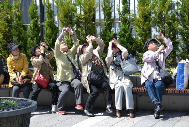 東京スカイツリーを撮影している人を撮影した本   roomie(ルーミー)
