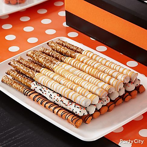 super easy halloween treats or a great party idea for any color theme dip pretzel rods in white and orange melting chocolate - Fast And Easy Halloween Treats