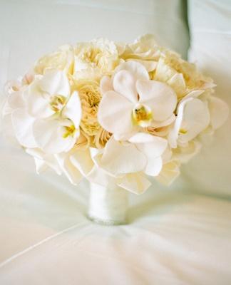 White orchid bridal bouquet // Photo: Esther Sun Photography // TheKnot.com