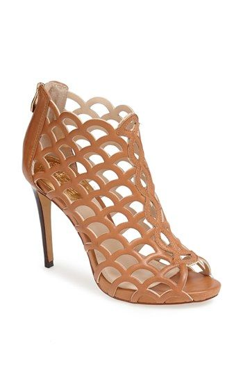 Perfect for summer! Love these light tan Vince Camuto caged sandals.