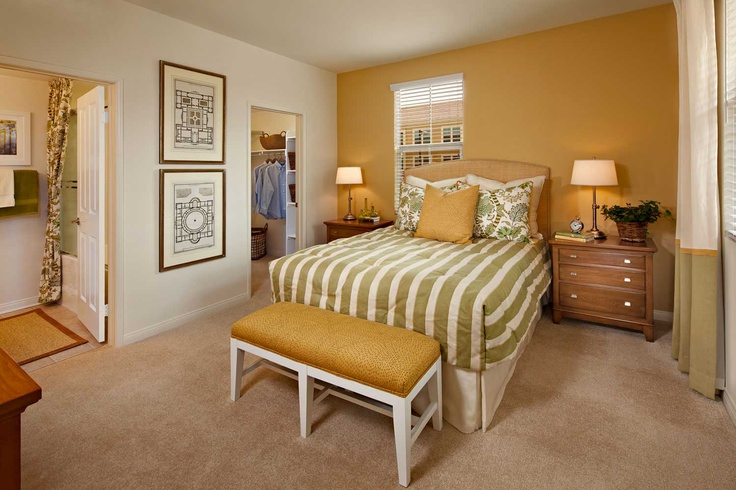 No gloomy days here! Brighten up your room with the vibrant yellow accents shown here in this master at Murano at Cypress Village in #Irvine  http://www.rental-living.com/Communities/Cadenza/  #masterbedroom #decor #design #yellow #accent wall #bedroom #bedding #lovewhereyoulive