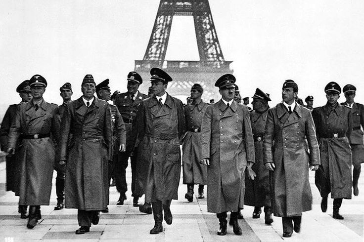 """Taken at the height of World War Two and after Adolf Hitler had taken Paris, this picture depicts Hitler surveying his conquest with his various cronies and became one of the most iconic photos of the 1940s and WWII."""