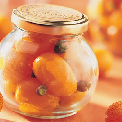 Preserved Kumquats | Preserving lemons with salt, a common practice in the Middle East and North Africa, makes them a powerful seasoning agent. Treated the same, little orange kumquats undergo a similar metamorphosis. They also become particularly attractive, making a tasteful gift. Use them in any recipe that calls for preserved lemon, or in the simple red pepper relish,to serve with chicken, pork, beef, lamb, fish--or salad.