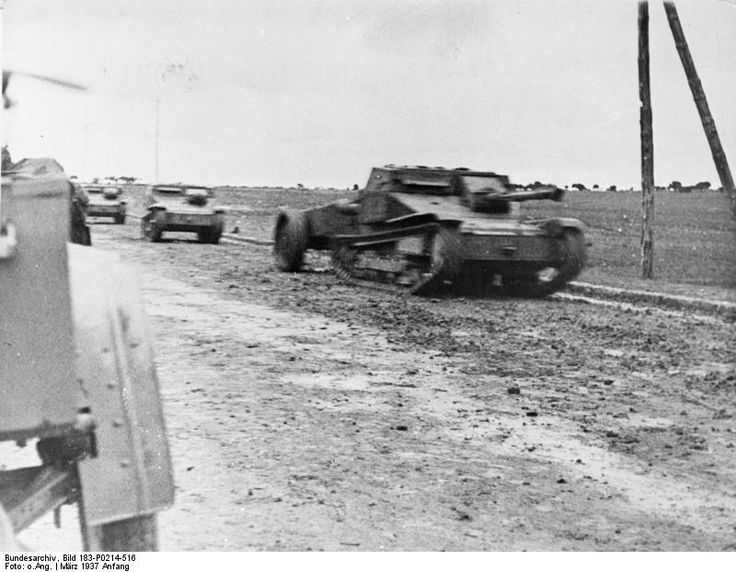 Italian tankettes advancing with a flame thrower tank in the lead at the Battle of Guadalajara.