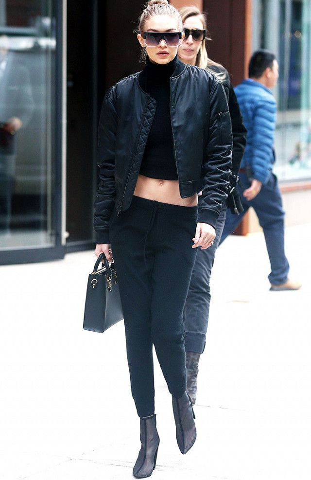 On Gigi Hadid: Unravel Projects bomber jacket; Sophie Hulme Black Albion Square Tote (£550); Yeezy boots. Shop Similar: Calvin Klein Collection Stretch-Cashmere Turtleneck...