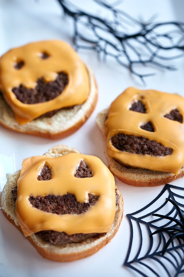 JACK O' LANTERN BURGERS Need a spooky idea for Halloween dinner? Cut your cheese slices into Jack 'O Lantern faces to get your guests into the Halloween spirit. This easy dinner recipe doesn't add any extra work but it will add some fun!