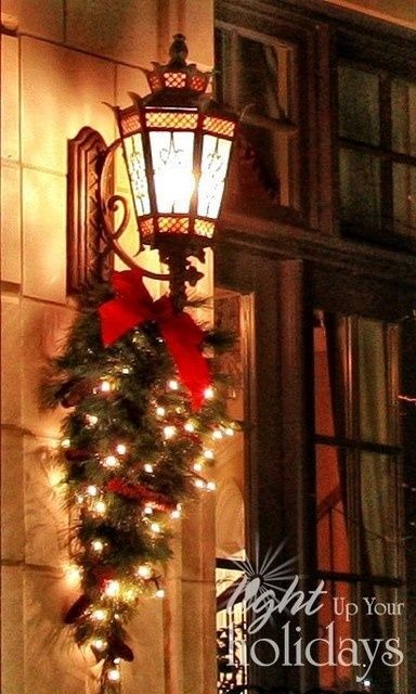 These types of lights by your front door or your garage doors always look so pretty with a teardrop swag. If you make them yourself, they're so inexpensive, but can be $50-$100. ea. if purchased.