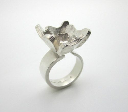 """Rey Urban (SE) for Åge Fausing (DK), modernist sterling silver floral ring, 1970s. 