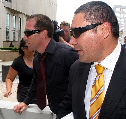 Alleged spammer Lance Atkinson (left) and his lawyer Darrell Kake (right) leave the Federal Court in Brisbane.