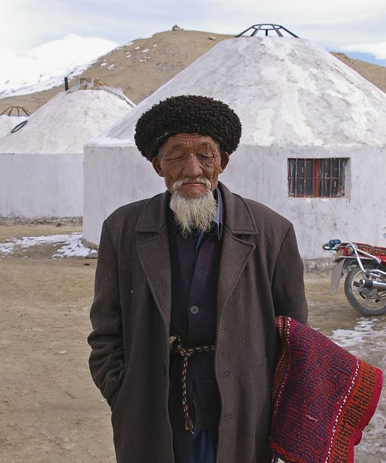 An old man with a yak's hair carpet to sell along the Karakoram highway