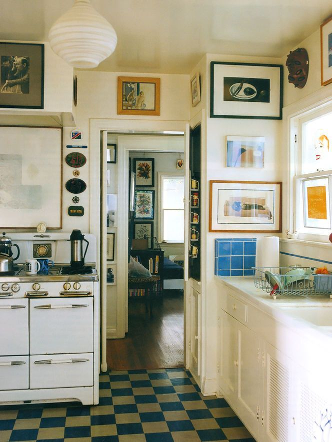 What an amazingly eclectic kitchen!  Artwork and floor