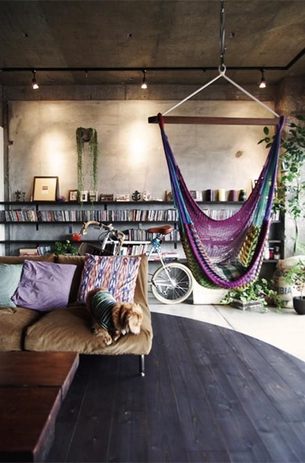 I like the idea of an indoor hanging chair or hammock. It appeals to my inner hooligan child. earth tones, wood floor, plants, track lights, coffee table, books, PUPPYYYYY