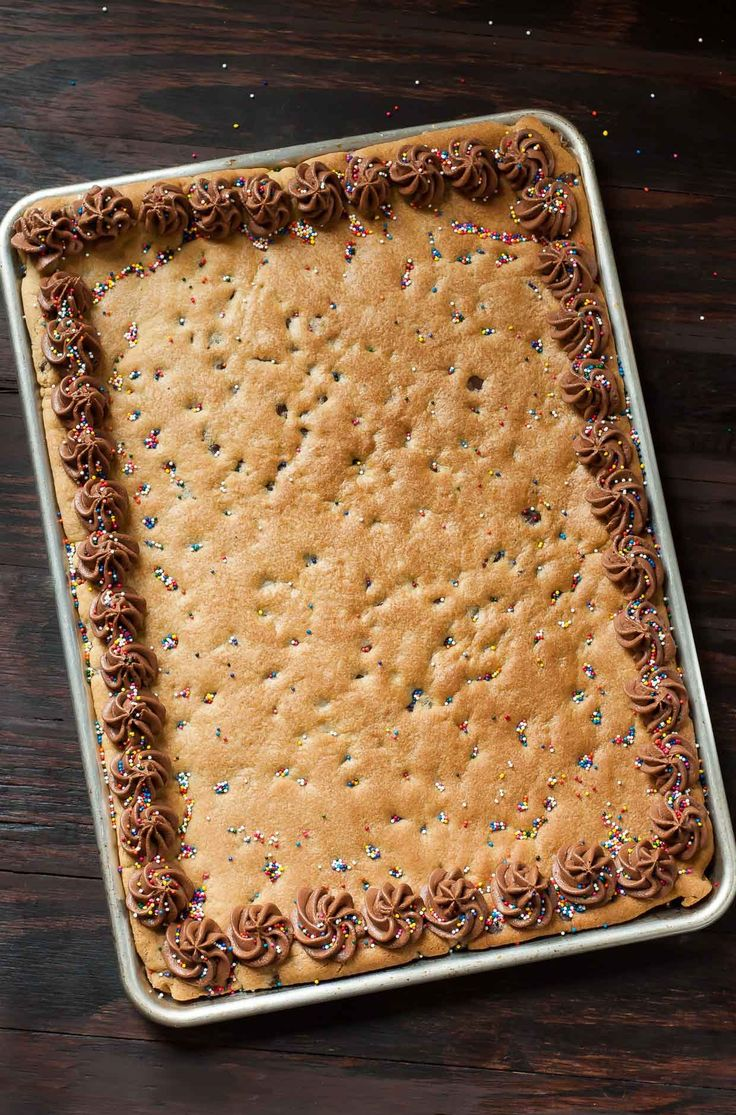 Homemade Sheet Pan Cookie Cake Recipe - This classic chocolate chip cookie cake is a total game changer in sheet pan form! Serves a crowd.