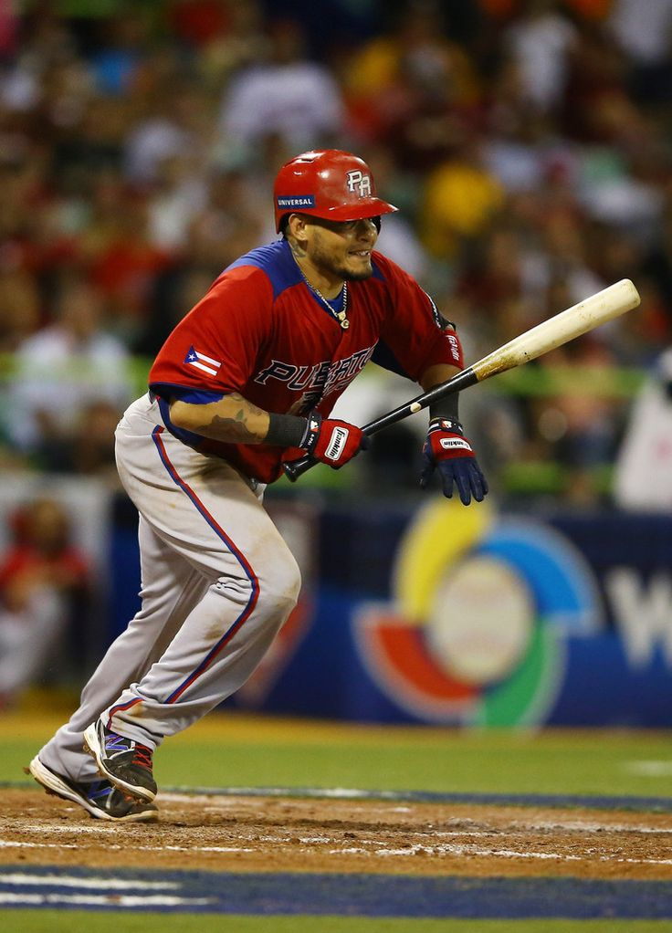 Yadier Molina #4 of Puerto Rico in action against Venezuela during the first round of the World Baseball Classic at Hiram Bithorn Stadium on March 9, 2013 in San Juan, Puerto Rico.