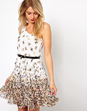 Love the one shoulder look and the butterfly print.