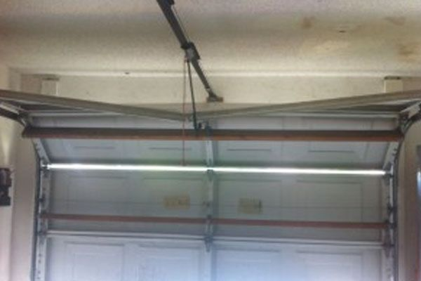 Garage Doors Are Relying On Heavy Duty Springs For Their Operations And The Door Manufacturers Garage Door Springs Garage Door Spring Repair Broken Garage Door