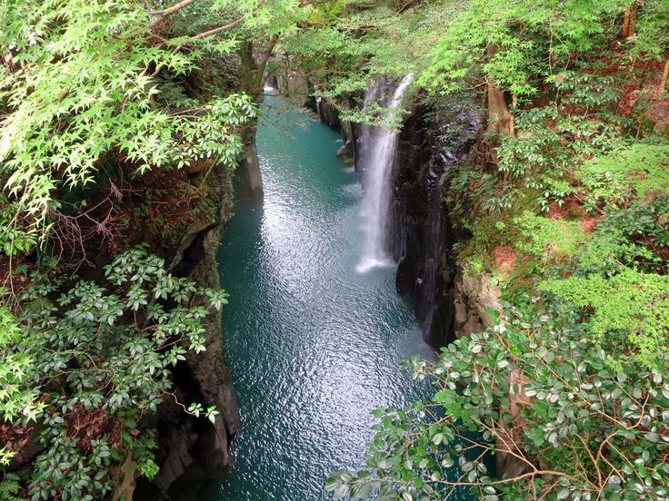Ancient volcanic activity on nearby Mount Aso created the columnar basalt cliffs which frame the Takachiho Gorge at Takachiho on Kyushu Island, Japan.