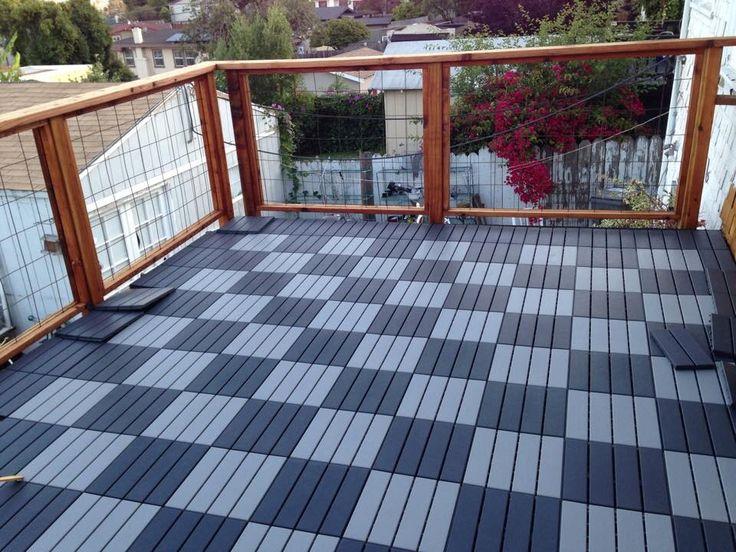 Ikea deck tiles over a flat roof deck. Ikea deck tiles