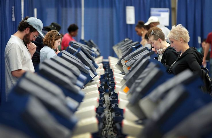 Image: Voters cast ballots for the presidential election at an early voting site in Chicago