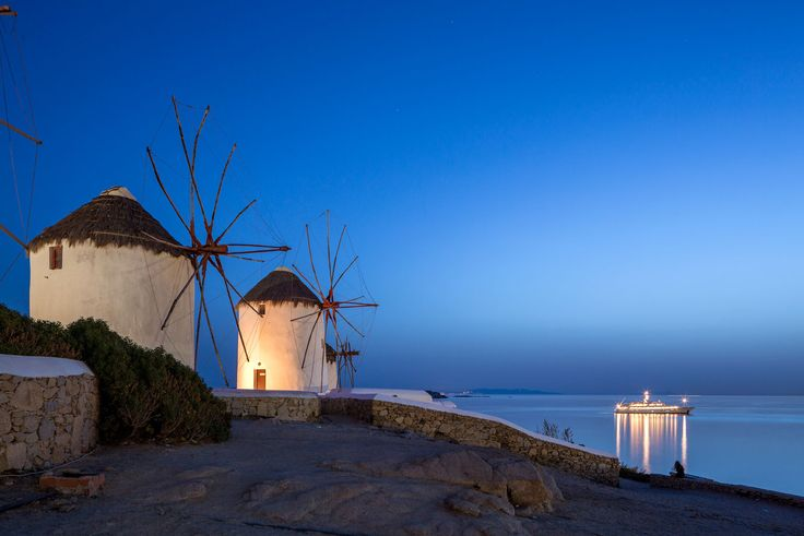 #MyconianTip: Explore the Windmills of Mykonos!   The snow-white windmills that adorn the cliff tops of Mykonos are one of the island's most prominent features. Take in the stunning views across the Aegean Sea to the surrounding islands as the sun sets!