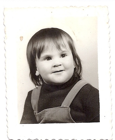 Probably my first Passport Picture. The photographer was able to make me smile, what a miracle!