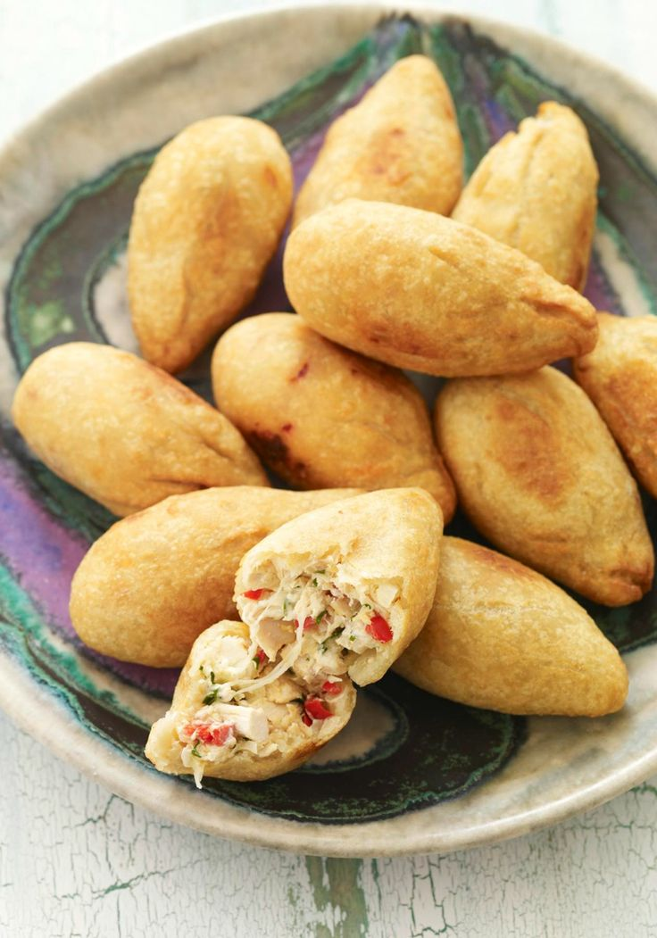 Chicken Crocodiles -- A traditional Brazilian street food, these pieces of deep-fried dough filled with chicken will make a great appetizer. 2 cups fat-free reduced-sodium chicken broth 2 cups flour, sifted 1 small onion, chopped 1 small red pepper, chopped 3 cups oil, divided 2 cups chopped cooked chicken 2 Tbsp. chopped fresh parsley 4 oz. (1/2 of 8-oz. pkg.) PHILADELPHIA Cream Cheese, cubed, softened 1/2 cup KRAFT Shredded Mozzarella Cheese with a TOUCH OF PHILADELPHIA