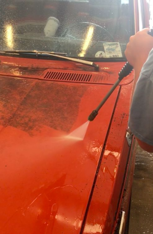 Pressure washing an old Toyota truck