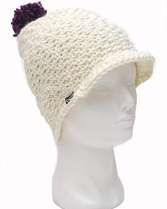 Outo blungy! This beanie is not only tall, but it also has a little cap. Finnish design made with love - out of Finnish Novita wool.