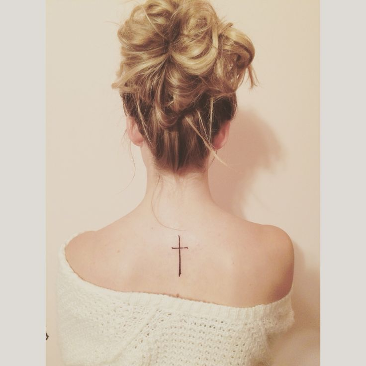 Back cross tattoo