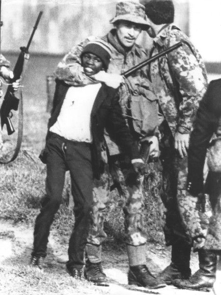 A South African policeman grabs a black student during a demonstration in Guguletu, near Cape Town, November 24, 1976. (Never forget what Mandela and others were up against. rw)