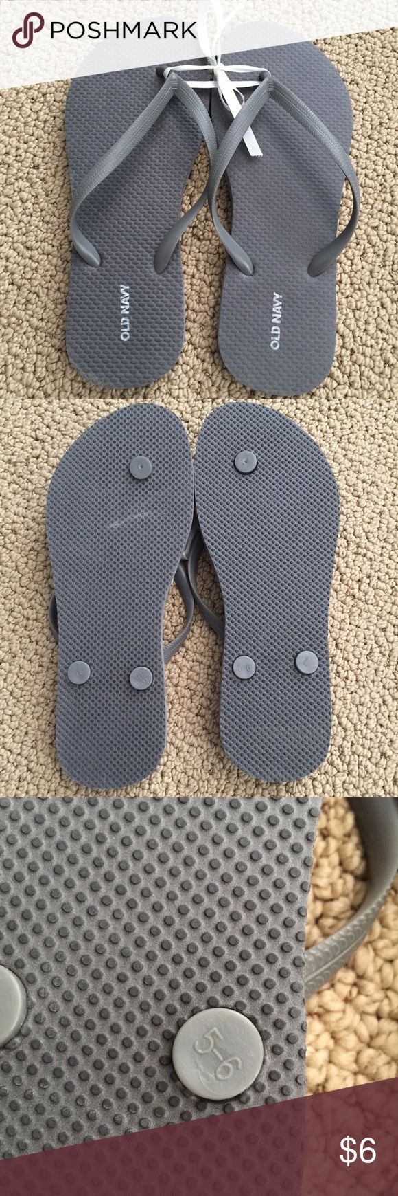 "NWT Classic Grey Flip Flops Classic grey flip flops. New with stickers, never worn. Marked as women's 6, a bit too short for me. 9 1/4"" length. Old Navy Shoes Sandals"