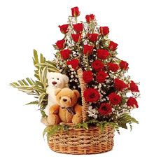 2 teddies in basket with red roses