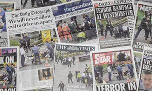 Newspaper front pages on the day after the attack.