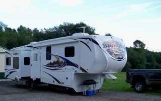 2012 Used Heartland Bighorn 3410RE Fifth Wheel in Virginia VA.Recreational Vehicle, rv, 2012 Heartland Bighorn 3610RE 4 season package Like new Well maintained Nonsmoking unit Great open floor plan for entertaining and full time living Sleeps 4 Tons of storage AC units in living room and bedroom Leather Hide-a-bed sofa with air mattress and large under sofa storage drawer 2 Leather rocker recliners Working Electric Fireplace Large LCD HD TV with under counter for storage Built in computer…