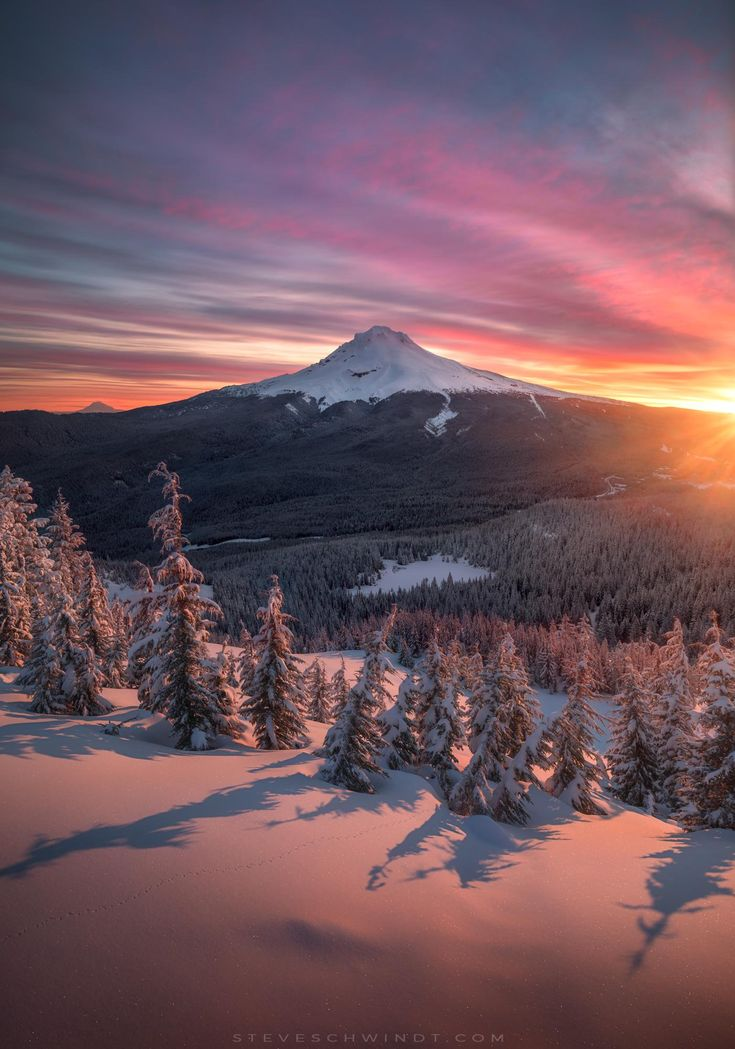 A gorgeous sunrise from this past weekend atop Tom Dick & Harry Mountain (Oregon) looking out at Mt. Hood after mid-April snow showers [OC] [1402x2000] -Please check the website for more pics